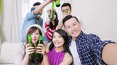 picture : young people take beer and selfie happily with party