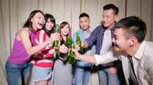 young people take beer and selfie happily with party