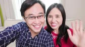 couple smile and selfie happily in the home