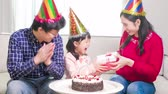 happy family smile happily with birthday cake in the home Stock Footage