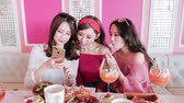 beauty women selfie and show heart gesture to you in restaurant