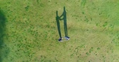 propeller : aerial view of couple walking on the grass