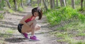vitela : sport woman feel pain with calf strain in the forest