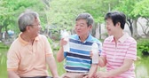 aposentar : old people chatting happily and drink water Stock Footage