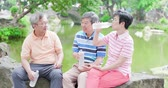 bebida quente : old people chatting happily and drink water Stock Footage