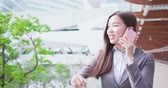 сотовый телефон : business woman smiles happily and speaks on phone