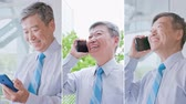ceo : Vertical Videos - old businessman smile happily and speak phone Stock Footage