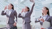 kiabálás : Vertical Videos - business woman take briefcase and feel excited Stock mozgókép