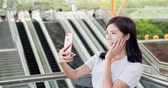 elevador : business woman take phone and selfie happily