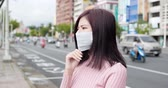tosse : woman feel headache and wear mask in the city