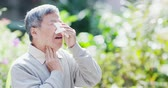 mendil : old man sneeze and feel throat pain outdoor