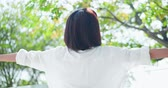 oddech : Back view of young woman feel carefree and take a deep breath at nature outdoor