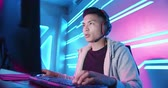 keyboard : Young Asian Handsome Pro Gamer concentrate in playing Online Video Game