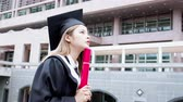 işsizlik : Girl gratuate think of future with diploma hoding in hand