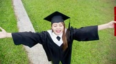 hr : Girl gratuate lift arm happily with diploma holding in hand