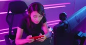 e sport : cybersport gamer have live stream and playing game on the smart phone Stock Footage