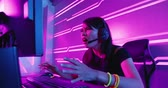sürpriz : Young asian esport gamer girl feel angry while playing in Online Video Game because of internet is down Stok Video