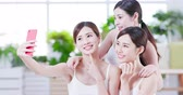 make photo : Smiling asian womans take selfie after the skin care in the spa salon