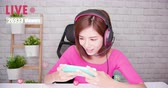 introduce : Young asian internet celebrity gamer girl introduce online mobile game to fans with smart phone and having live stream Stock Footage
