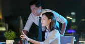 話し合う : asian businessman and businesswoman overtime work and discuss something in the office