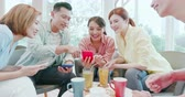 grupo : asian woman and man watch something on smart phone happily Stock Footage