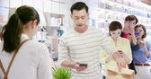 財布 : mobile payment concept - young man buy coffee and Pays bills by Phone to Credit Card System