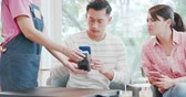 財布 : mobile payment concept - man Pays bills by Phone to Credit Card System but occur error 動画素材