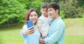 fete des peres : Young parent take selfie with child happily at park