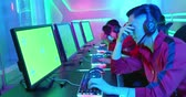 Team of asian teenage cyber sport gamers lose the multiplayer PC video game and feel upset with green screen