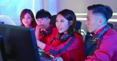 Team of asian teenage cyber sport gamers discuss about their strategy before play in multiplayer PC video game on eSport tournament Wideo