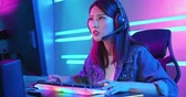 storing : Young asian esport gamer girl feel angry while playing in Online Video Game because of keyboard is stop working Stockvideo