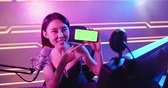 asian girl have live stream and show app on the 5g smartphone with green screen