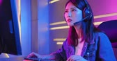 Young asian esport gamer girl feel angry while playing in Online Video Game because of mouse is stop working