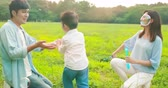 slow motion of asian parents play bubbles with kid outdoor and boy run happily