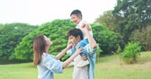 slow motion of asian parents play with kid and boy sit on dad shoulder