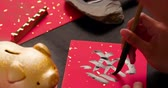 salvar : asian people write calligraphy on couplet to celebrate chinese new year with word meaning rich Vídeos
