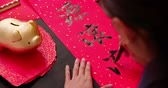 zodiaque chinois : asian people write calligraphy on couplet to celebrate chinese new year with word meaning rich Vidéos Libres De Droits