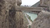kings canyon : Walkers in El Caminito del Rey with final bridge, static camera Stock Footage