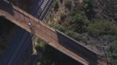 бдительность : Top view of mountain bike cyclist over bridge and railway Стоковые видеозаписи