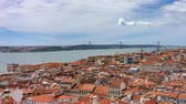 lisszabon : Lisbon roofs timelapse with Tagus river and suspension bridge