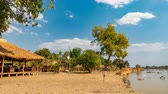 zambia : Time lapse of Luangwa river with wooden shacks Stock Footage