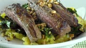 бифштекс : flank steak with mashed plantain , collard greens and ginger peanuts