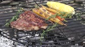t bone steak with vegetables cooking on fire