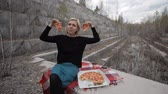 letét : beautiful woman improvises with pizza on a marble background Stock mozgókép