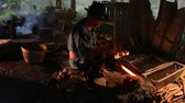 пожар : Professional Blacksmith at work is Hit the iron by a hot metal With fire