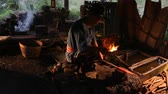 Professional Blacksmith at work is Hit the iron by a hot metal With fire