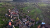 rumunia : Aerial drone footage of countryside village houses in late afternoon lights. Manastireni, Transylvania, Romania