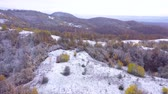 romanya : Flying over snowy hills and forest. First snowfall of the year. Aerial 4k drone movie Stok Video