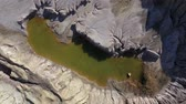геология : Aerial drone 4k movie of abandoned and flooded open pit gypsum mine, quarry. Polluted lake and mud. Industrial landscape