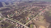 поднятый : Aerial 4k view of a village settlement from a drone in Transylvania, Romania Стоковые видеозаписи